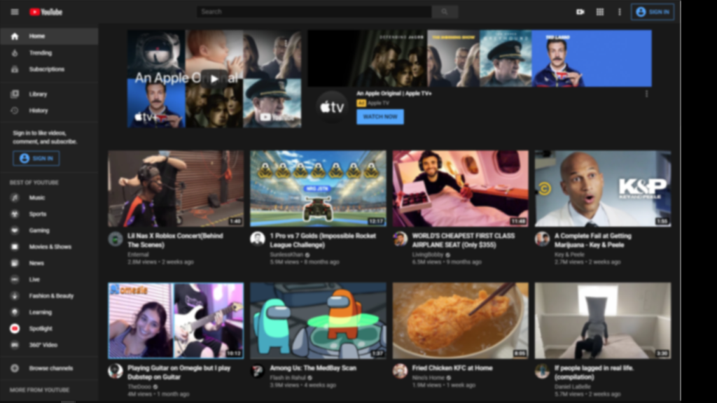 Sample of YouTube homepage which has a blurred vision simulation.